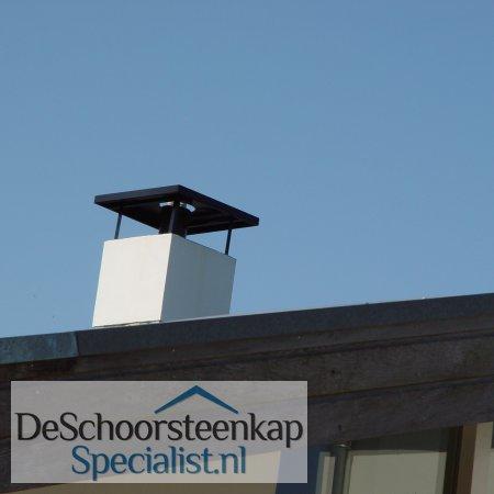 Een vlakke schoorsteenkap met doorvoer