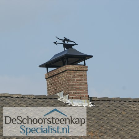 Een schoorsteenkap zadeldak met windwijzer vlag!